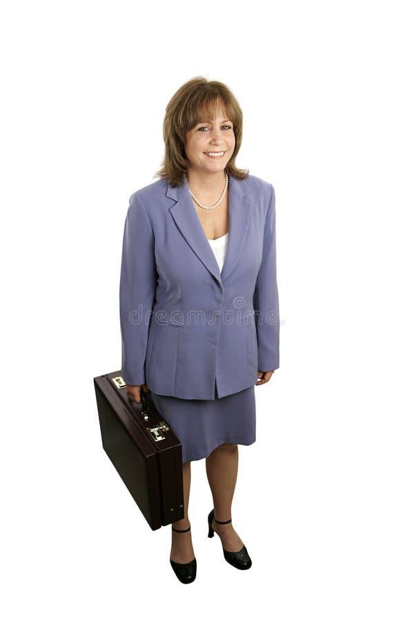 La femme d'affaires de sourire se terminent image stock
