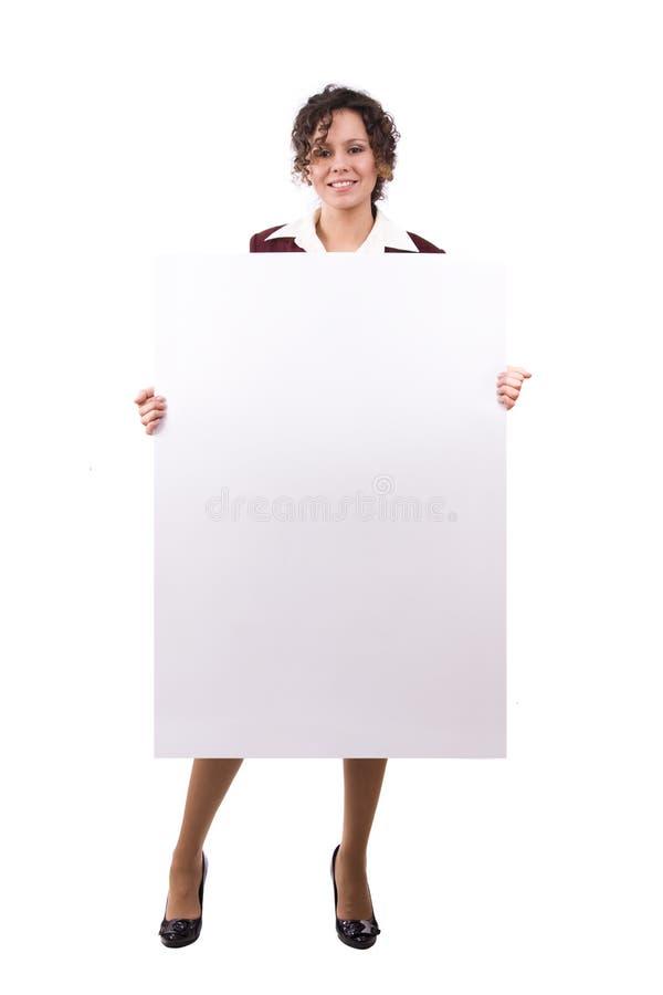 La femme d'affaires est panneau-réclame de fixation. photos stock
