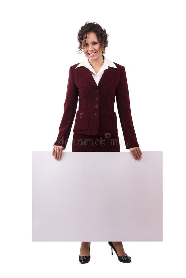 La femme d'affaires est panneau-réclame de fixation. photographie stock
