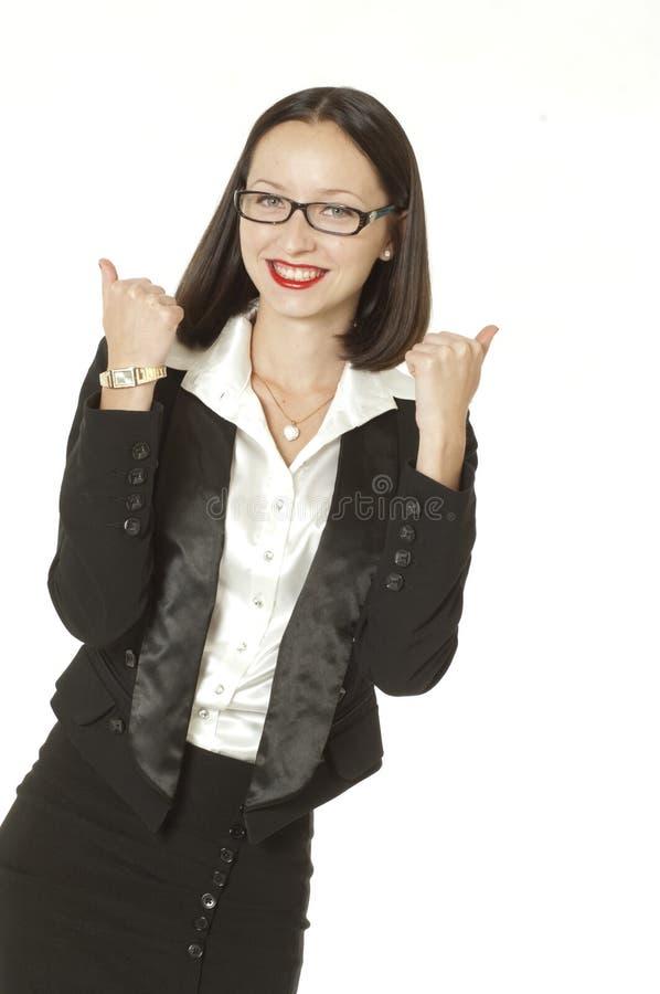 La femme d'affaires manie maladroitement vers le haut photo libre de droits