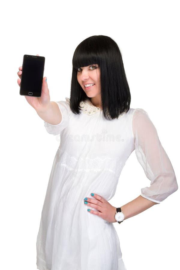 La femme d'affaires montre le téléphone intelligent photos stock