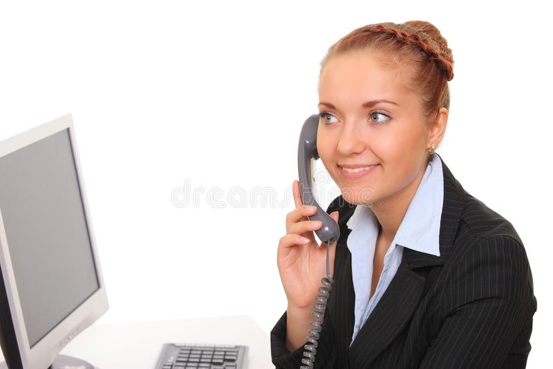 La femme d'affaires parle par le téléphone photos libres de droits
