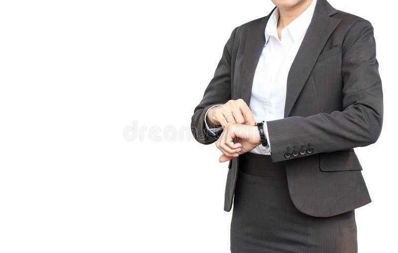 La femme d'affaires regardent sa montre sur d'isolement photographie stock libre de droits