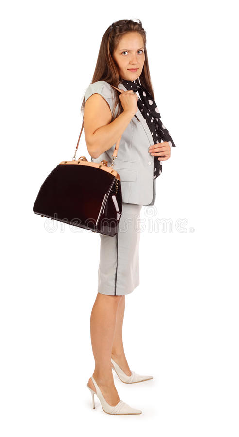 La femme d'affaires retient le sac dans le studio photos stock