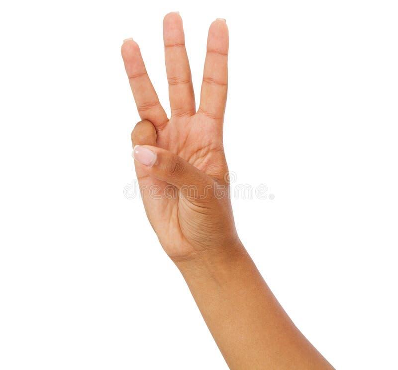 La femme de couleur montrent le tiers, signe du numéro trois d'isolement sur le fond blanc, bras afro-américain photo libre de droits