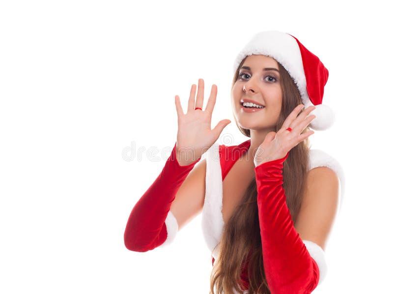 La femme de Noël heureux a excité disent bonjour d'isolement sur le backgr blanc image libre de droits