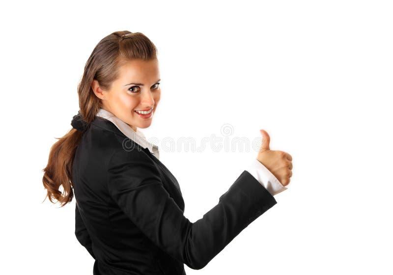 La femme de sourire d'affaires affichant des pouces lèvent le geste photos libres de droits