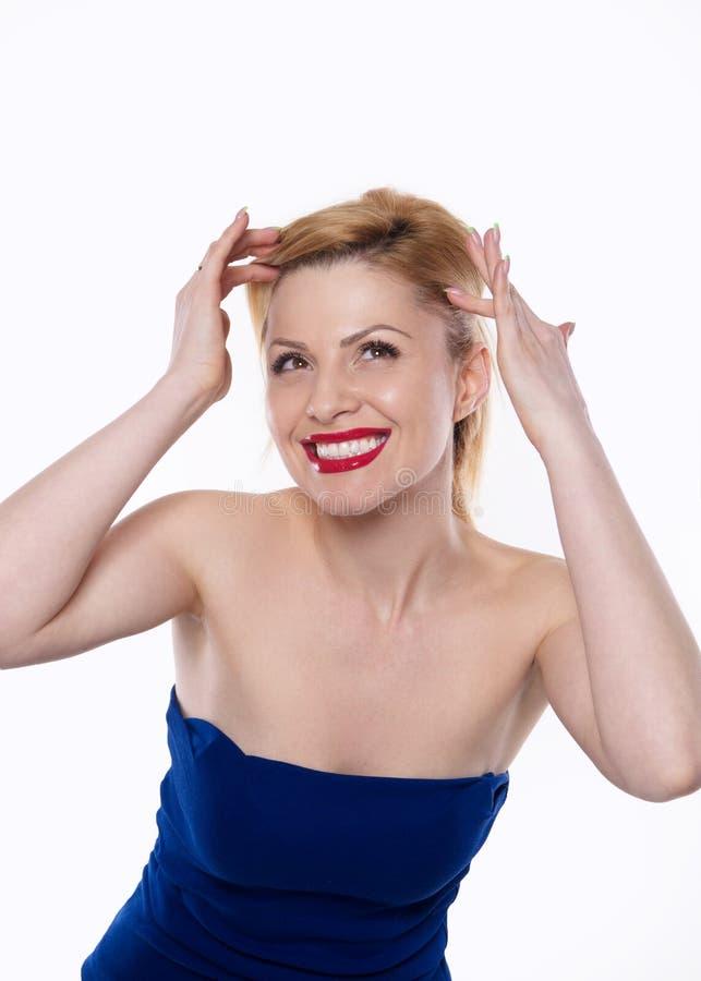 La femme expressive de belle émotion blonde d'isolement photographie stock libre de droits