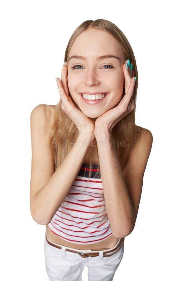 La femme heureuse surmontent avec joie tenant ses mains sur ses joues As photo libre de droits