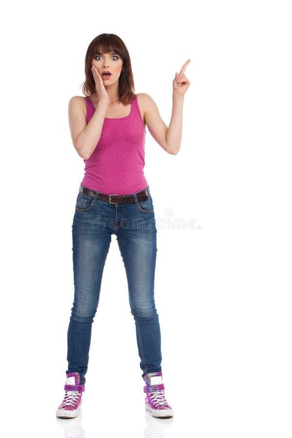 La femme inquiétée tient la main sur Chin And Pointing Up images stock