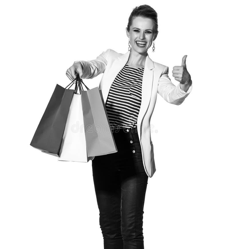 La femme montrant le drapeau français colore des paniers et des pouces  photo stock