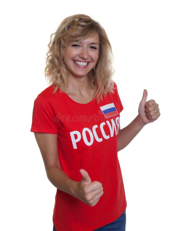 La femme russe aime le football photo libre de droits