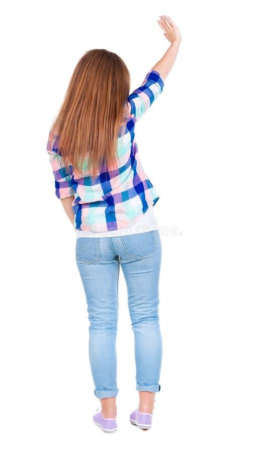 La femme salue heureusement quelqu'un Ondulation de fille image stock