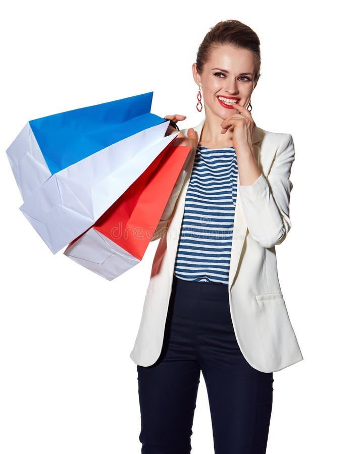 La femme songeuse avec le drapeau français colore des paniers photos libres de droits