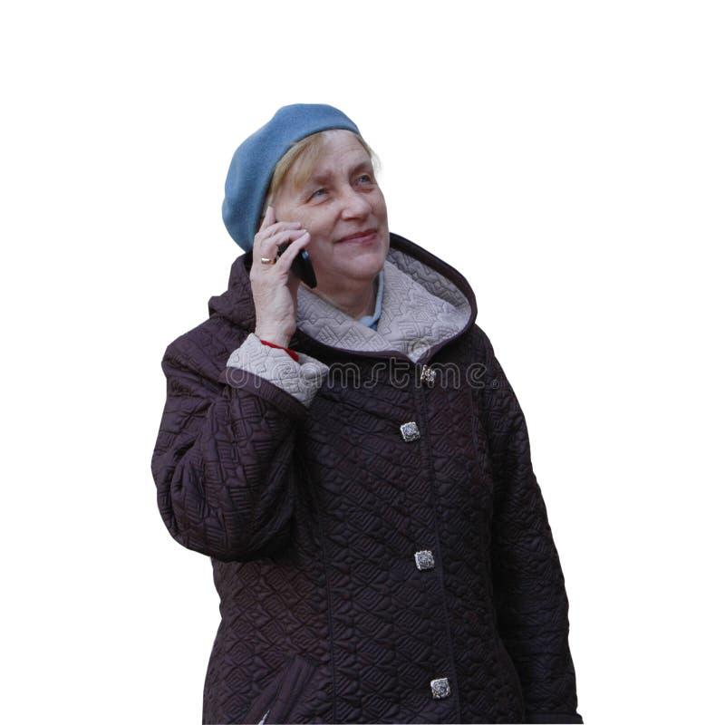 La femme supérieure fait des entretiens au téléphone portable images stock