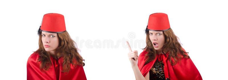La femme utilisant le chapeau de Fez d'isolement sur le blanc image stock