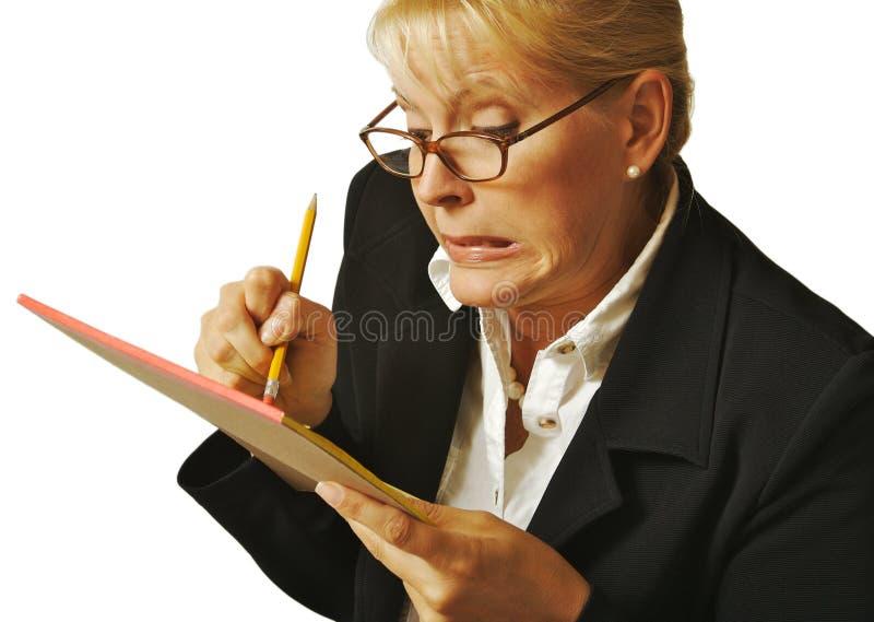 La femmina cancella l'errore delle note fotografia stock