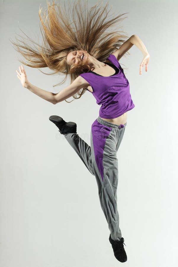 La femmina che salta su fotografia stock libera da diritti