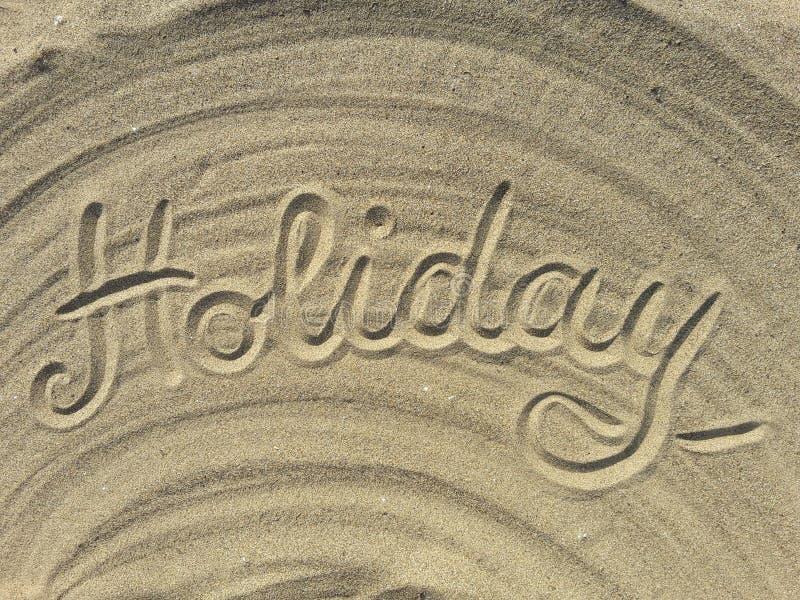 La festa scrive sulla sabbia immagini stock libere da diritti