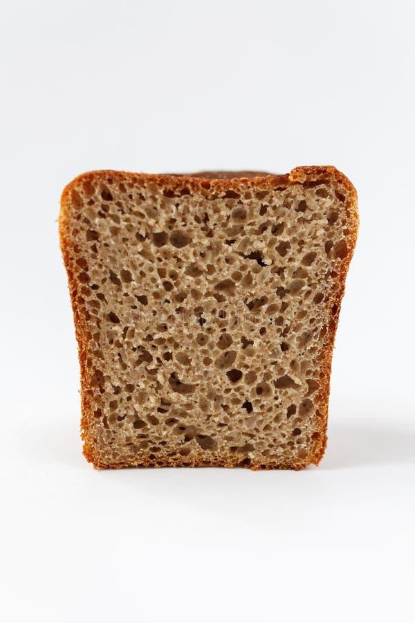 La fetta di pane del pane, icona del forno, ha affettato il pane integrale fresco isolato su fondo bianco immagini stock libere da diritti