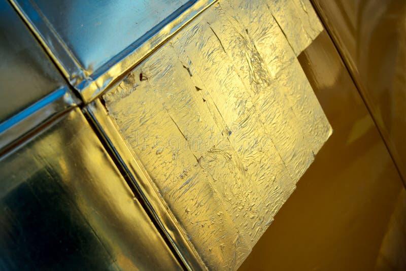 La feuille d'or couvre la surface photographie stock