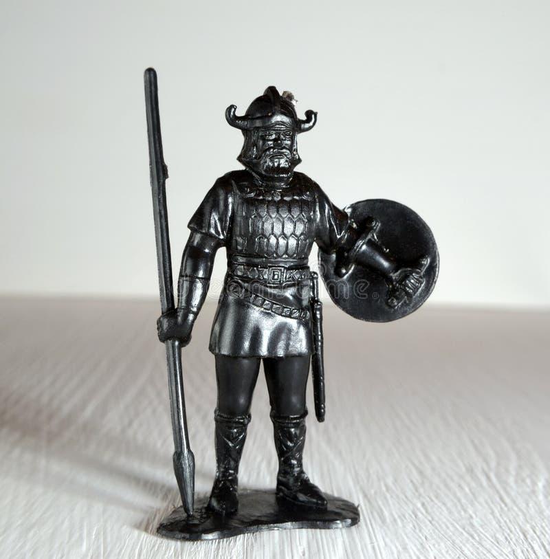 La figurina nera di vichingo ha modellato di plastica fotografie stock