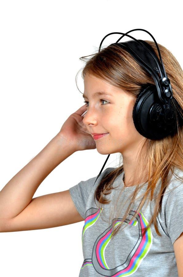 La fille aiment des écouteurs de musique photo libre de droits