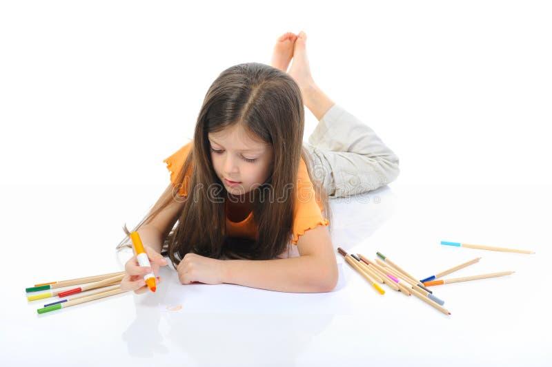 La fille aux cheveux longs dessine photographie stock libre de droits