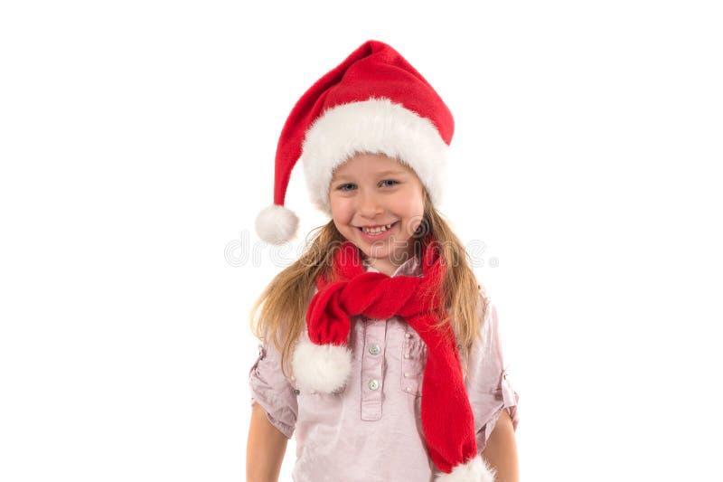 La fille dans le chapeau du ` s de Santa Claus photo stock