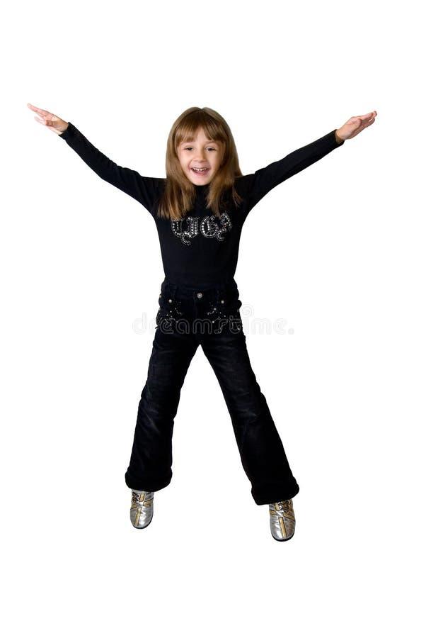 La fille dans le noir dans un saut photo libre de droits