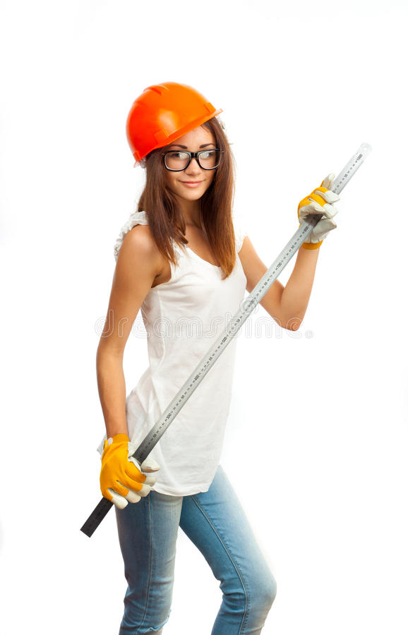 La fille dans un casque orange photographie stock