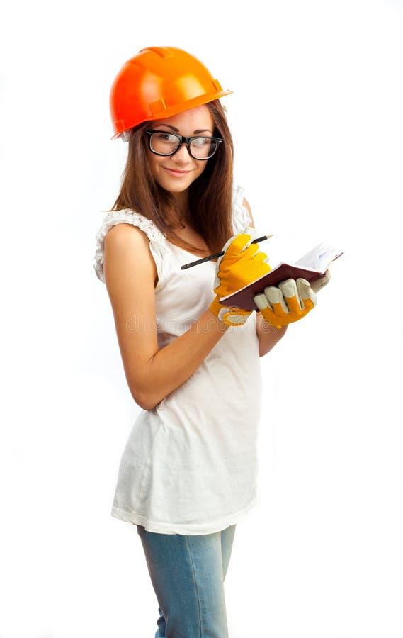 La fille dans un casque orange image libre de droits