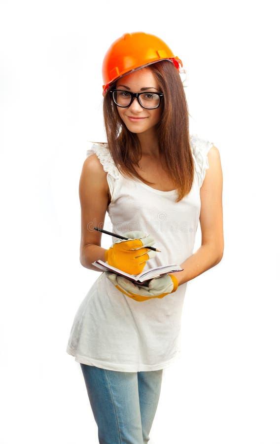La fille dans un casque orange image stock