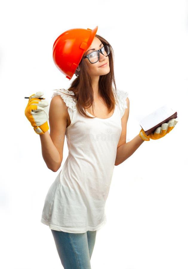 La fille dans un casque orange photos libres de droits