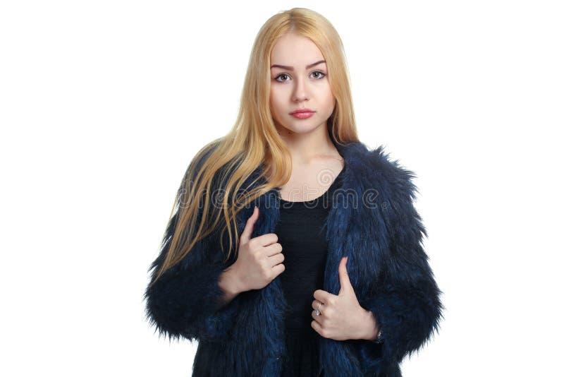 La fille dans un manteau de fourrure photo stock