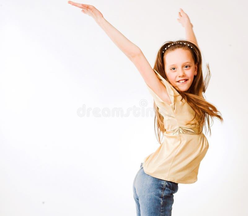 la fille de fond saute le blanc image stock