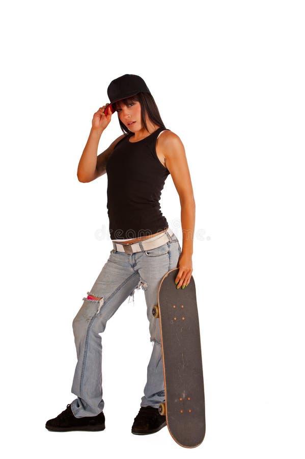 La fille de patineur saisit son chapeau photographie stock