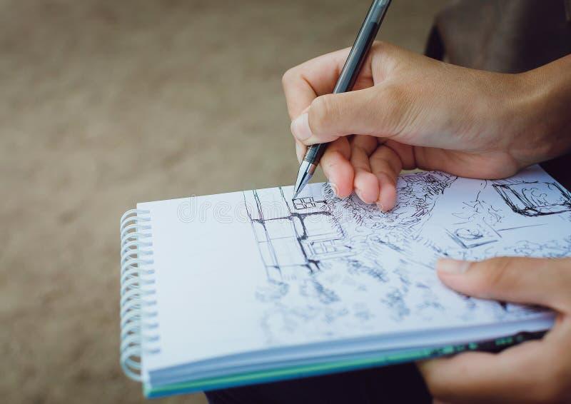 La fille dessine dans un carnet Remet le plan rapproché illustration de vecteur
