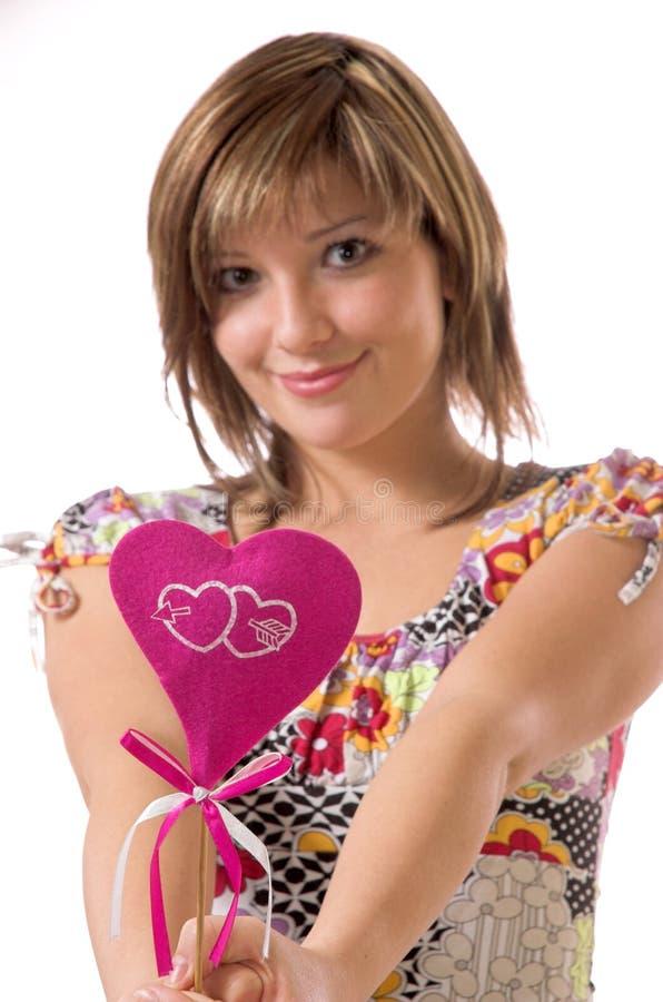 La fille et le coeur gais images libres de droits