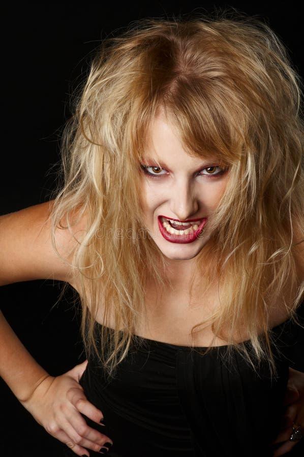 La fille fâchée dans le studio images stock