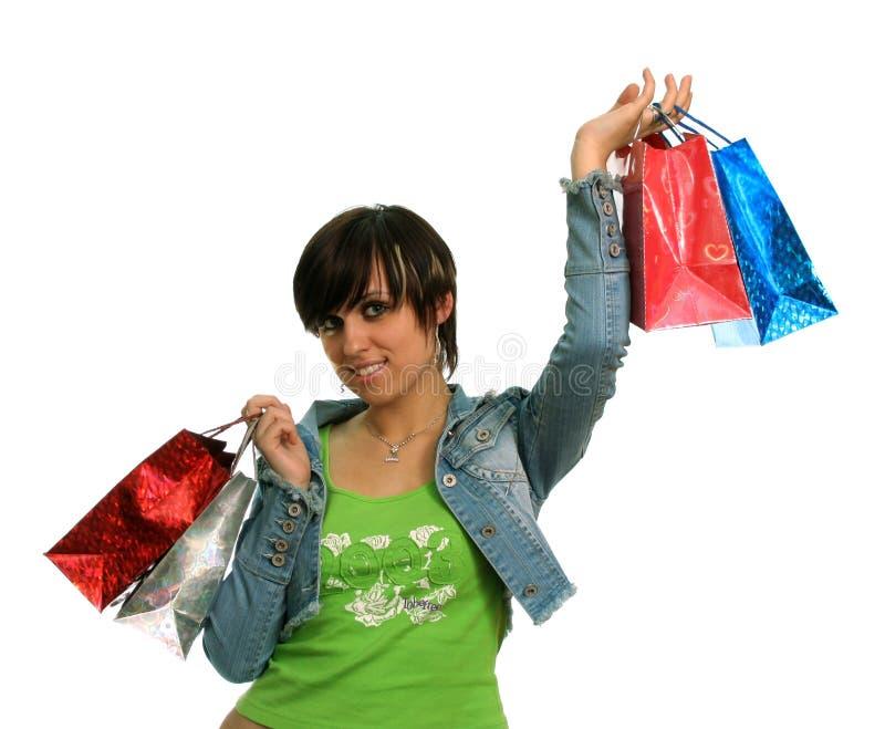 La fille heureuse avec des achats photographie stock libre de droits