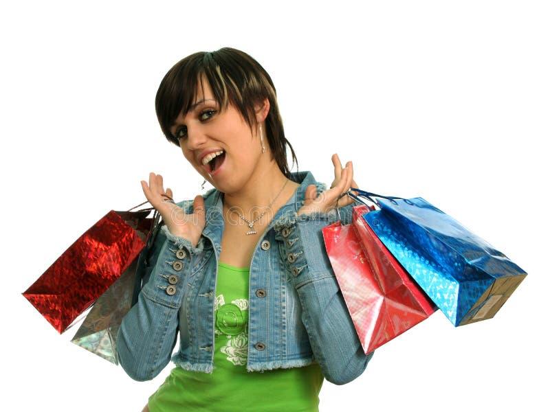 La fille heureuse avec des achats photo libre de droits