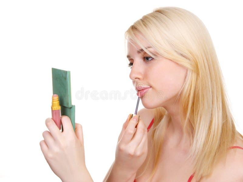 La fille peint des languettes image stock