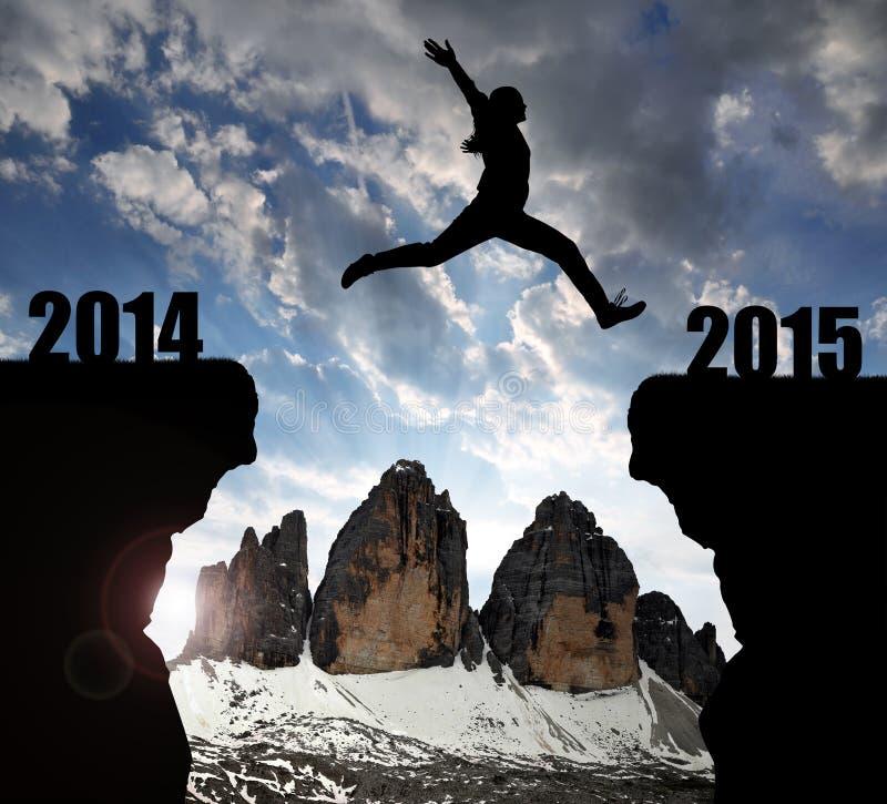 La fille saute à la nouvelle année 2015 photos stock