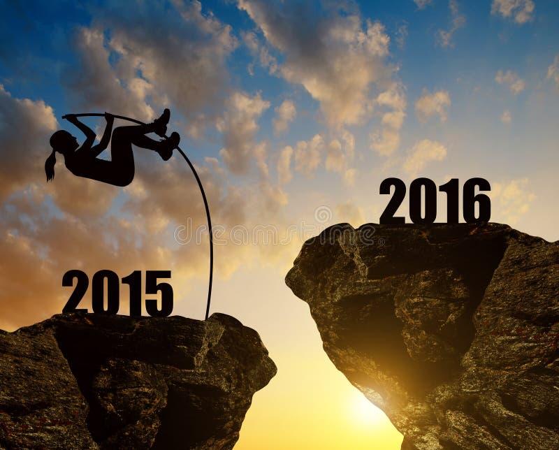 La fille saute à la nouvelle année 2016 photographie stock