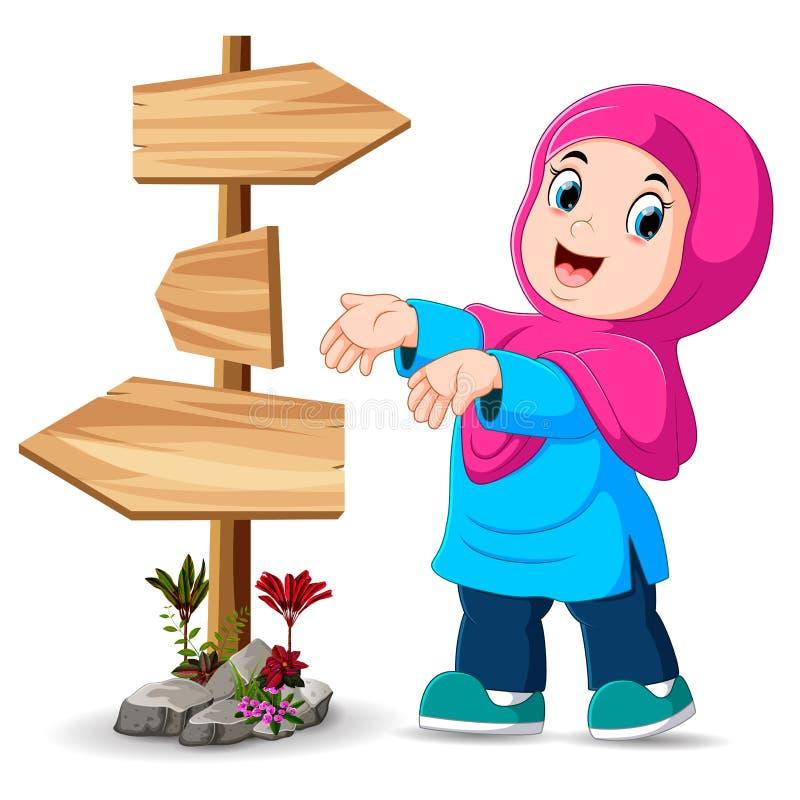 la fille se tient près du poteau indicateur et montre la bonne manière illustration libre de droits