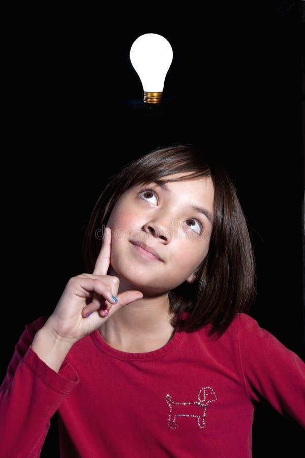 La fille a une idée. photographie stock