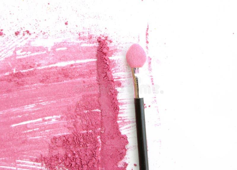 La fin de couleur rose écrasée composent avec la brosse sur le blanc photos libres de droits