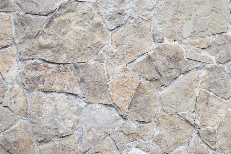 La fine su ha potato il calcestruzzo marrone strutturato dettagliato ruvido liscio geometrico e la parete di pietra grigia grigia fotografie stock libere da diritti
