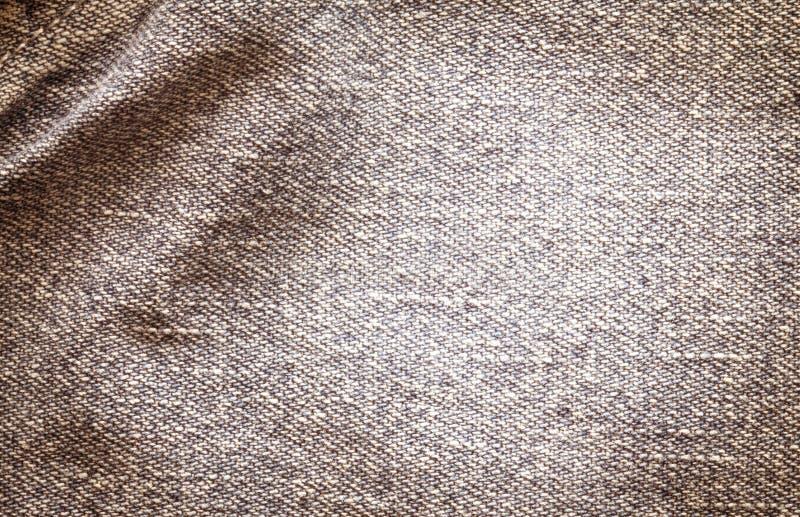 La fine sulle blue jeans luminose del denim sorge con il BAC di struttura dell'onda immagine stock libera da diritti